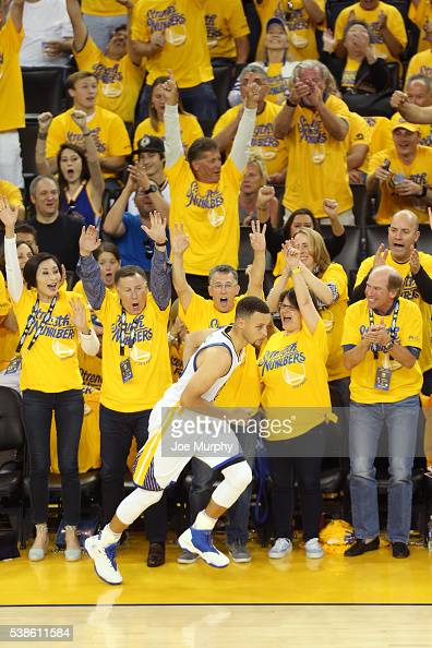 Stephen Curry of the Golden State Warriors runs up court as the crowd celebrates during Game Two of the 2016 NBA Finals against the Cleveland...