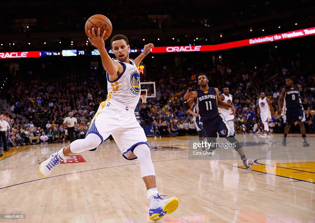 <a gi-track='captionPersonalityLinkClicked' href=/galleries/search?phrase=Stephen+Curry+-+Basketball+Player&family=editorial&specificpeople=5040623 ng-click='$event.stopPropagation()'>Stephen Curry</a> #30 of the Golden State Warriors saves the ball from going out of bounds then makes a three-point basket over Mike Conley #11 of the Memphis Grizzlies at ORACLE Arena on November 2, 2015 in Oakland, California.