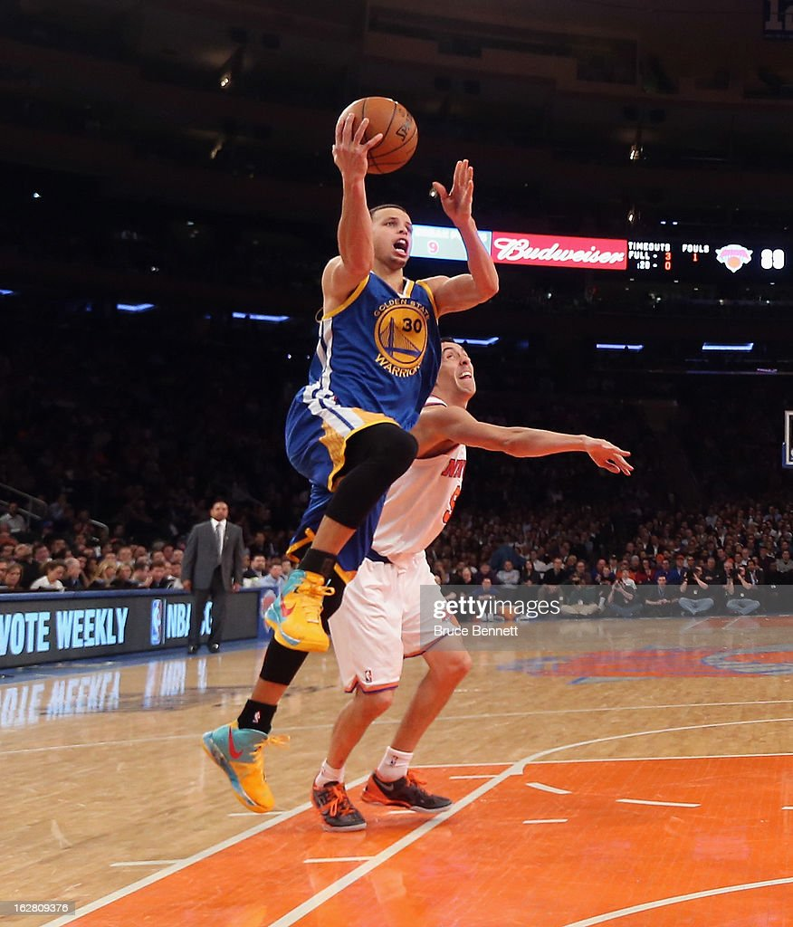 Stephen Curry #30 of the Golden State Warriors scores two of his 54 against the New York Knicks at Madison Square Garden on February 27, 2013 in New York City.