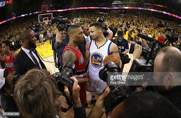 Stephen Curry of the Golden State Warriors shakes hands with Damian Lillard of the Portland Trail Blazers after the Warriors beat the Trail Blazers...