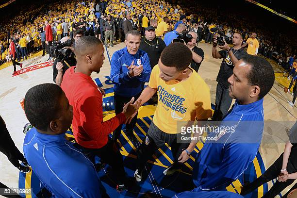 Stephen Curry of the Golden State Warriors shakes hands with Damian Lillard of the Portland Trail Blazers in Game Five of the Western Conference...