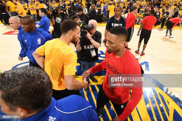 Stephen Curry of the Golden State Warriors shakes hands with Damian Lillard of the Portland Trail Blazers before the Western Conference Quarterfinals...