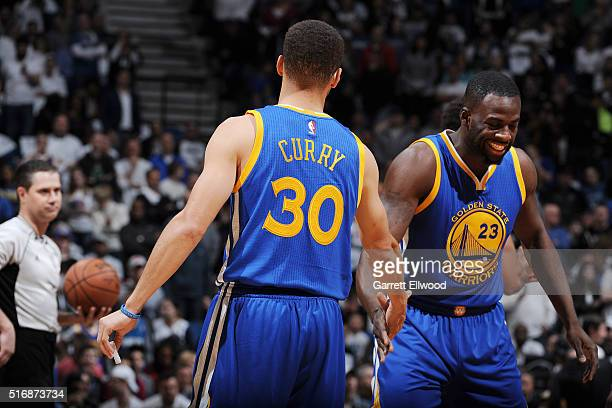 Stephen Curry of the Golden State Warriors shakes hands with Draymond Green of the Golden State Warriors during the game against the Minnesota...