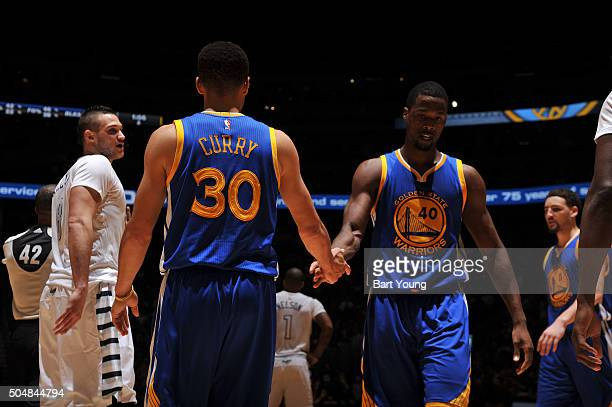 Stephen Curry of the Golden State Warriors shakes hands with Harrison Barnes of the Golden State Warriors during the game against the Denver Nuggets...