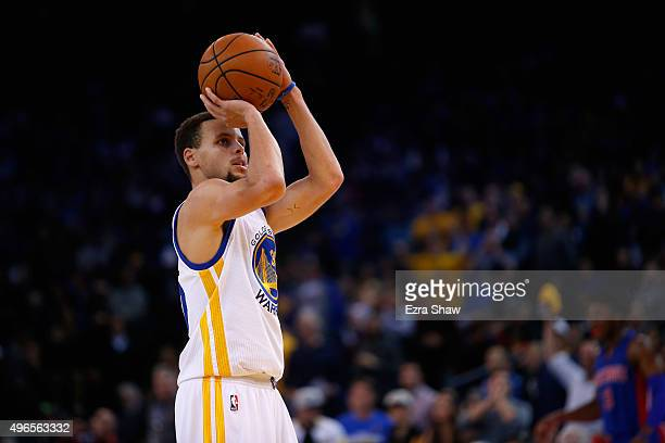 Stephen Curry of the Golden State Warriors shoots a free throw against the Detroit Pistons at ORACLE Arena on November 9 2015 in Oakland California...