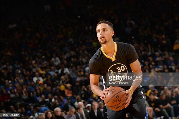 Stephen Curry of the Golden State Warriors shoots a free throw against the Sacramento Kings on November 28 2015 at ORACLE Arena in Oakland California...
