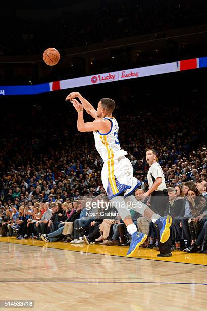 Stephen Curry of the Golden State Warriors shoots a half court shot against the Orlando Magic on March 7 2016 at ORACLE Arena in Oakland California...