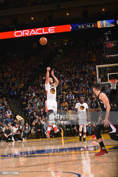 Stephen Curry of the Golden State Warriors shoots a half court shot during the game against the Los Angeles Clippers on January 28 2017 at oracle...