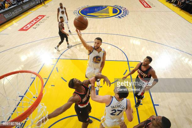 Stephen Curry of the Golden State Warriors shoots a lay up during the game against the Portland Trail Blazers during the Western Conference...