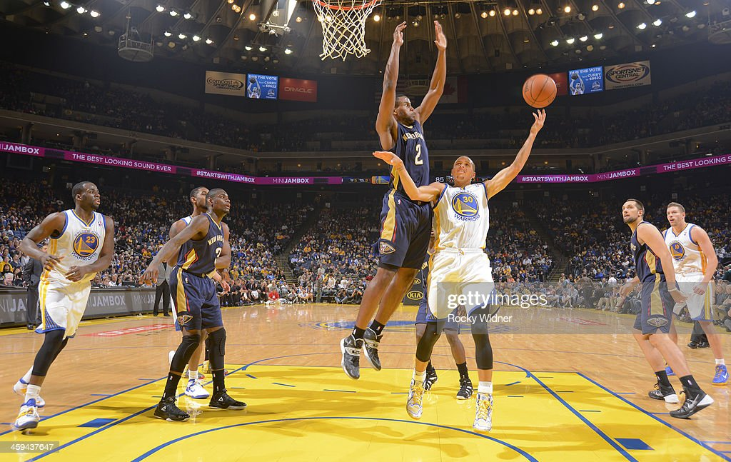 Stephen Curry #30 of the Golden State Warriors shoots a layup against Darius Miller #2 of the New Orleans Pelicans on December 17, 2013 at Oracle Arena in Oakland, California.