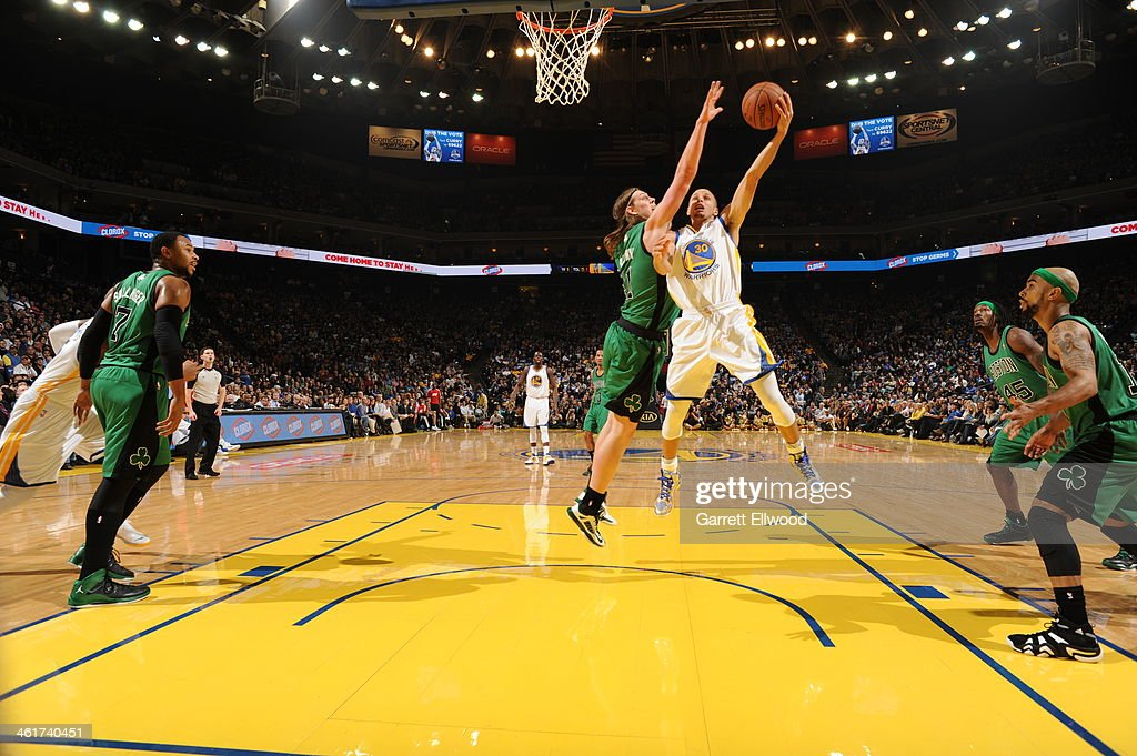 Stephen Curry #30 of the Golden State Warriors shoots a layup against <a gi-track='captionPersonalityLinkClicked' href=/galleries/search?phrase=Kelly+Olynyk&family=editorial&specificpeople=5953512 ng-click='$event.stopPropagation()'>Kelly Olynyk</a> #41 of the Boston Celtics on January 10, 2014 at Oracle Arena in Oakland, California.