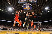 Stephen Curry of the Golden State Warriors shoots a layup against Steven Adams of the Oklahoma City Thunder on February 6 2016 at Oracle Arena in...