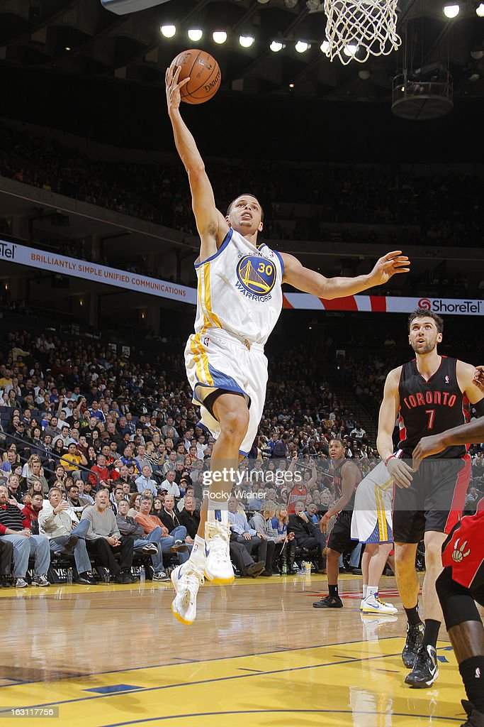 Stephen Curry #30 of the Golden State Warriors shoots a layup against the Toronto Raptors on March 4, 2013 at Oracle Arena in Oakland, California.