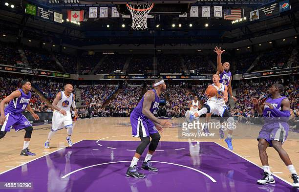 Stephen Curry of the Golden State Warriors shoots a layup against the Sacramento Kings on October 29 2014 at Sleep Train Arena in Sacramento...