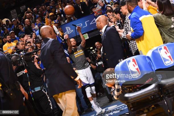 Stephen Curry of the Golden State Warriors shoots a shot from the tunnel before the game against the Houston Rockets on March 31 2017 at ORACLE Arena...