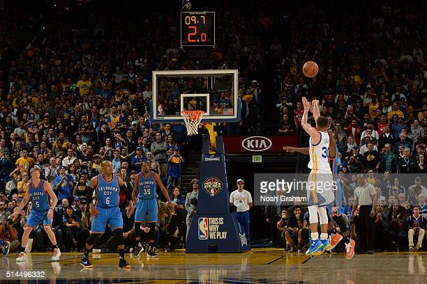 Stephen Curry of the Golden State Warriors shoots a three point basket against the Oklahoma City Thunder on March 3 2016 at ORACLE Arena in Oakland...