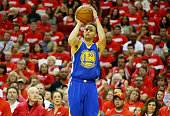 Stephen Curry of the Golden State Warriors shoots a three pointer in the third quarter against the Houston Rockets during Game Three of the Western...
