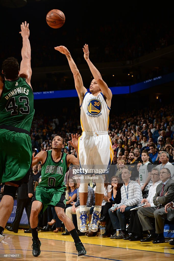 Stephen Curry #30 of the Golden State Warriors shoots a three pointer against the Boston Celtics on January 10, 2014 at Oracle Arena in Oakland, California.