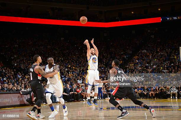 Stephen Curry of the Golden State Warriors shoots a three pointer against Maurice Harkless of the Portland Trail Blazers on March 11 2016 at Oracle...