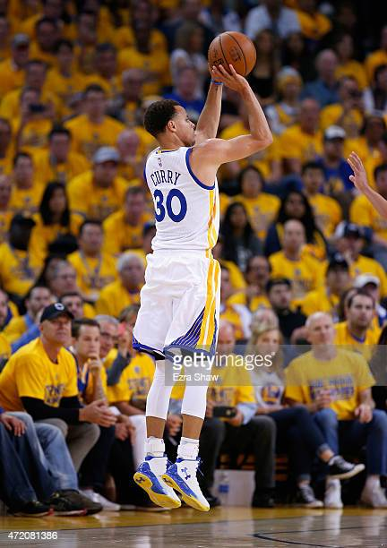 Stephen Curry of the Golden State Warriors shoots a threepoint basket against the Memphis Grizzlies during Game One of the Western Conference...