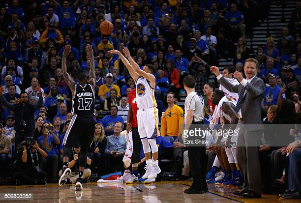 Stephen Curry of the Golden State Warriors shoots a threepoint basket over Jonathon Simmons of the San Antonio Spurs at ORACLE Arena on January 25...
