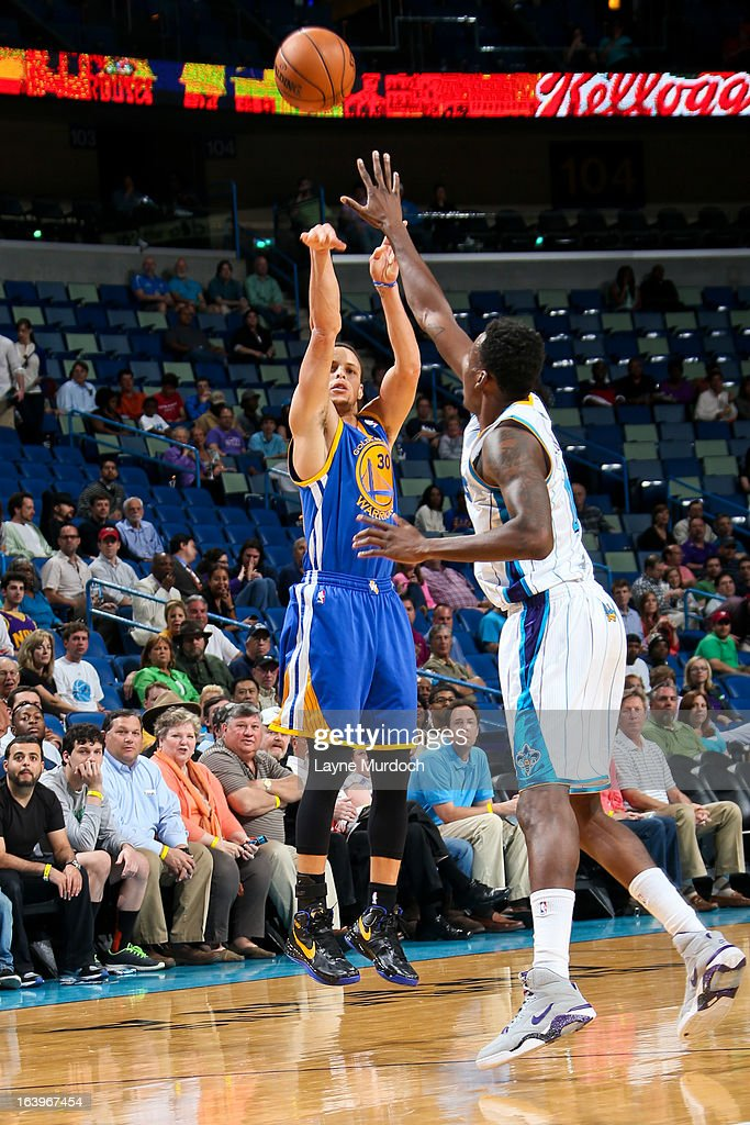 Stephen Curry #30 of the Golden State Warriors shoots a three-pointer against Al-Farouq Aminu #0 of the New Orleans Hornets on March 18, 2013 at the New Orleans Arena in New Orleans, Louisiana.