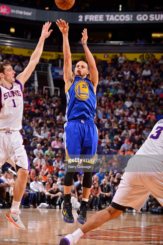 Stephen Curry #30 of the Golden State Warriors shoots a three-pointer against <a gi-track='captionPersonalityLinkClicked' href=/galleries/search?phrase=Goran+Dragic&family=editorial&specificpeople=4452965 ng-click='$event.stopPropagation()'>Goran Dragic</a> #1 of the Phoenix Suns on April 5, 2013 at U.S. Airways Center in Phoenix, Arizona.