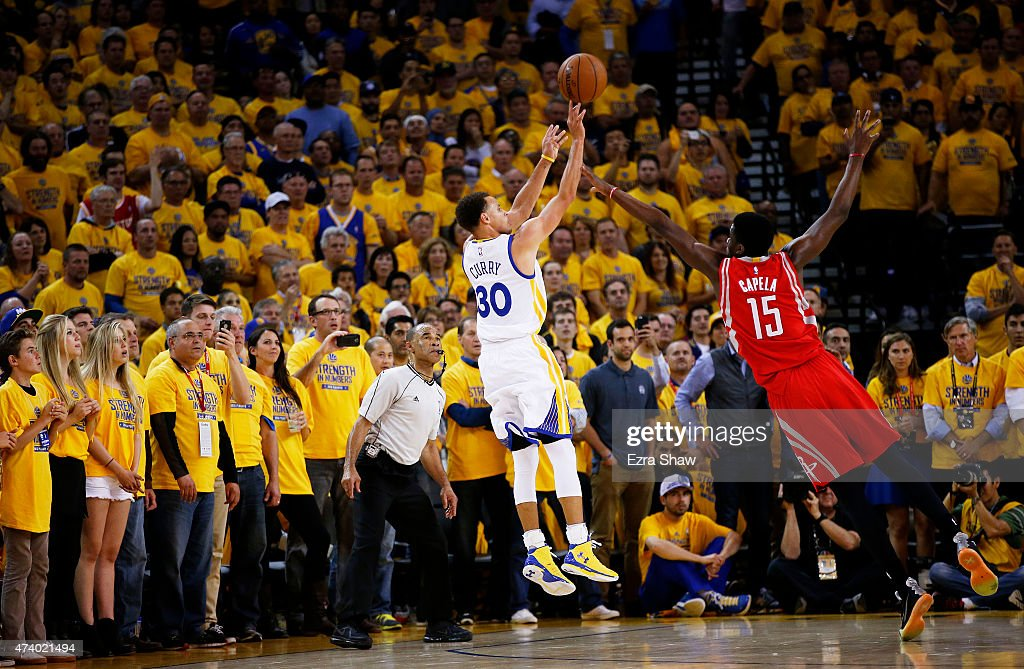Stephen Curry of the Golden State Warriors shoots a two pointer against Clint Capela of the Houston Rockets to end the second quarter during Game One...