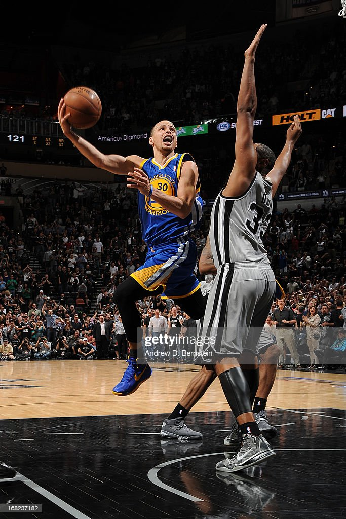 Stephen Curry #30 of the Golden State Warriors shoots against Boris Diaw #33 of the San Antonio Spurs in Game One of the Western Conference Semifinals during the 2013 NBA Playoffs on May 6, 2013 at the AT&T Center in San Antonio, Texas.