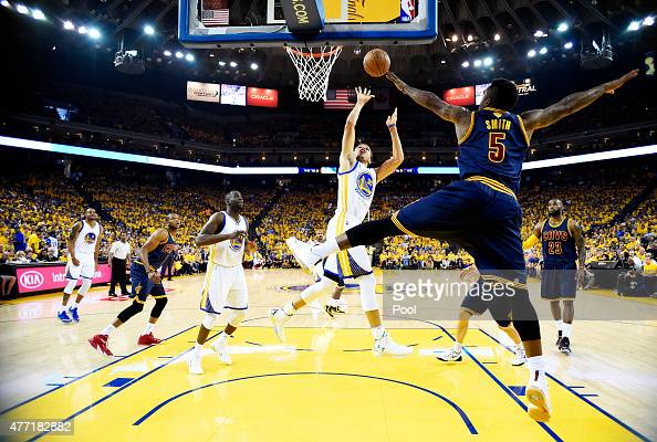 Stephen Curry of the Golden State Warriors shoots against JR Smith of the Cleveland Cavaliers in the first half during Game Five of the 2015 NBA...
