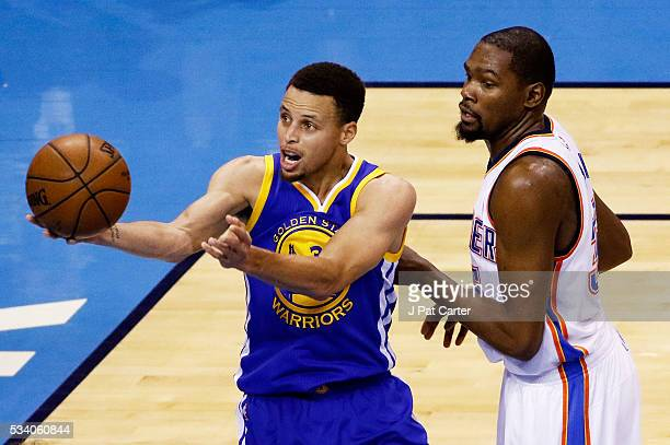 Stephen Curry of the Golden State Warriors shoots against Kevin Durant of the Oklahoma City Thunder in the first half in game four of the Western...