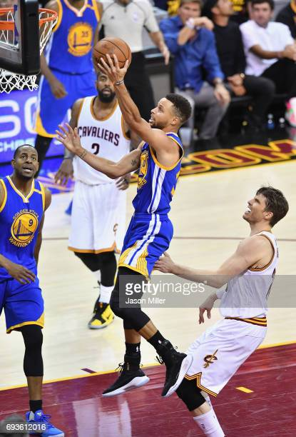 Stephen Curry of the Golden State Warriors shoots against Kyle Korver of the Cleveland Cavaliers in the second half in Game 3 of the 2017 NBA Finals...