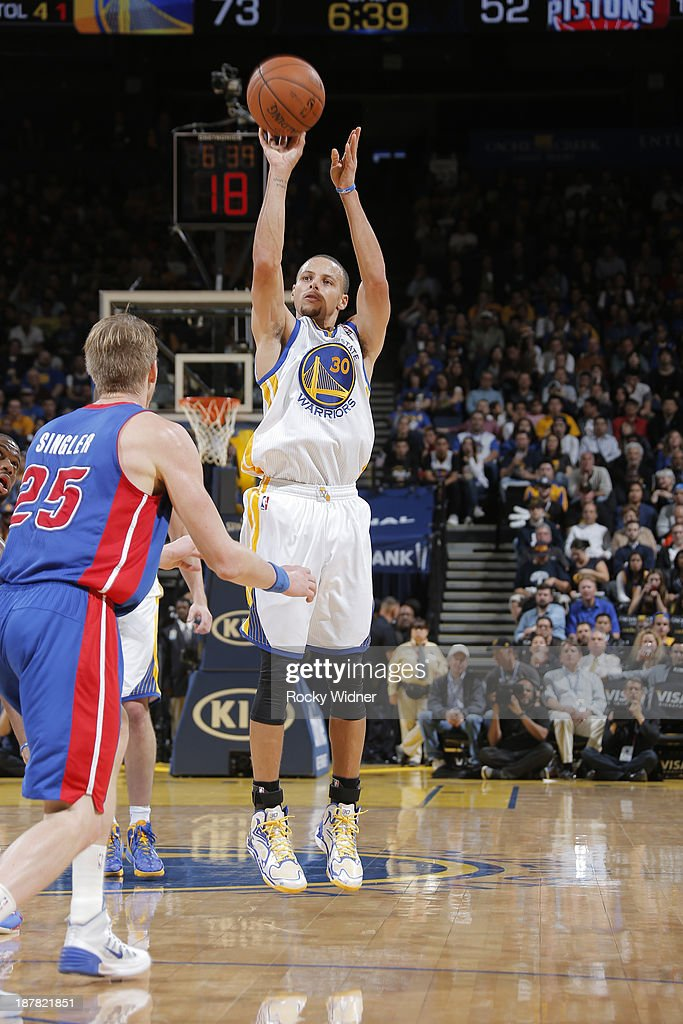 Stephen Curry #30 of the Golden State Warriors shoots against <a gi-track='captionPersonalityLinkClicked' href=/galleries/search?phrase=Kyle+Singler&family=editorial&specificpeople=4216029 ng-click='$event.stopPropagation()'>Kyle Singler</a> #25 of the Detroit Pistons on November 12, 2013 at Oracle Arena in Oakland, California.