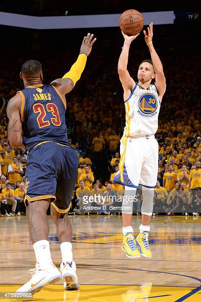 Stephen Curry of the Golden State Warriors shoots against LeBron James of the Cleveland Cavaliers during Game One of the 2015 NBA Finals on June 4...