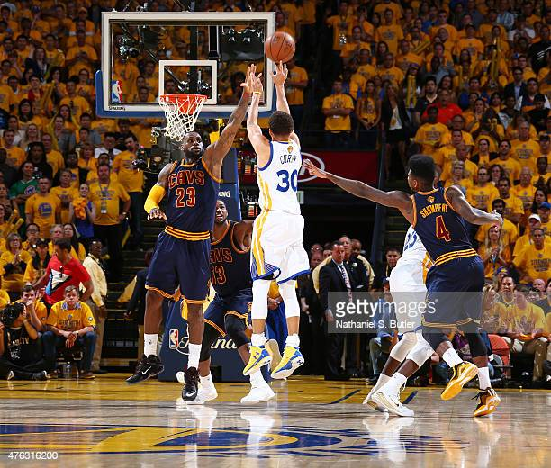 Stephen Curry of the Golden State Warriors shoots against LeBron James of the Cleveland Cavaliers during Game Two of the 2015 NBA Finals on June 7...