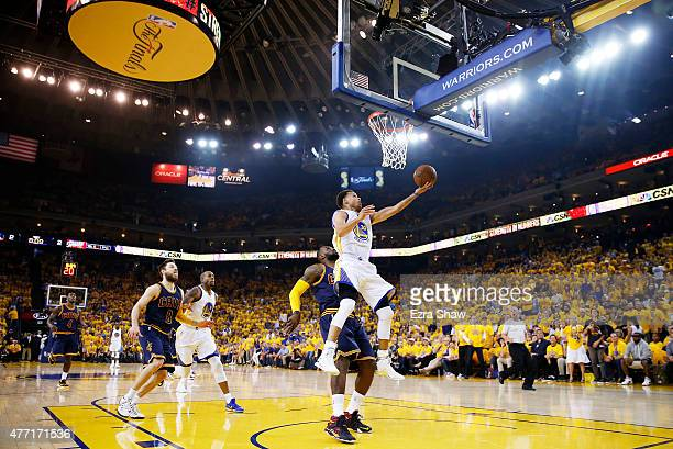 Stephen Curry of the Golden State Warriors shoots against LeBron James of the Cleveland Cavaliers in the first quarter during Game Five of the 2015...