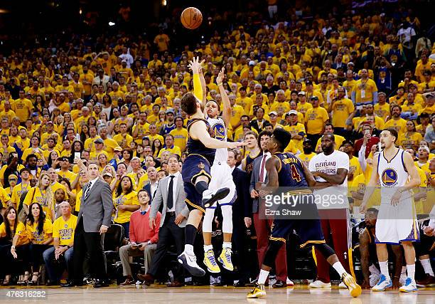 Stephen Curry of the Golden State Warriors shoots against Matthew Dellavedova of the Cleveland Cavaliers in overtime during Game Two of the 2015 NBA...