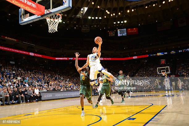 Stephen Curry of the Golden State Warriors shoots against Shelvin Mack of the Utah Jazz on March 9 2016 at Oracle Arena in Oakland California NOTE TO...