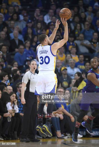Stephen Curry of the Golden State Warriors shoots against the Charlotte Hornets during an NBA basketball game at ORACLE Arena on February 1 2017 in...