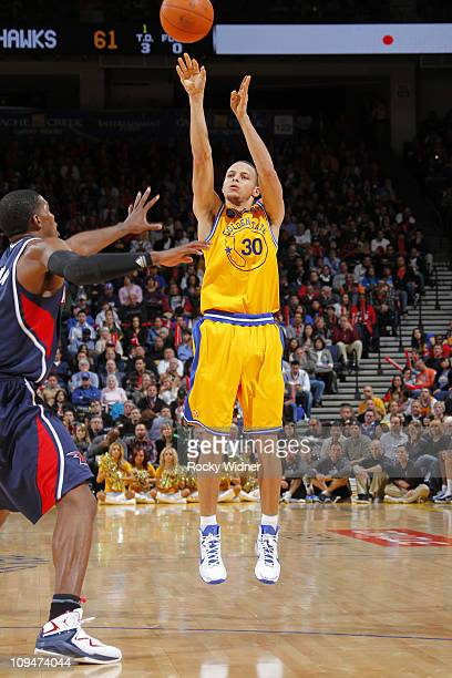 Stephen Curry of the Golden State Warriors shoots against the Atlanta Hawks on February 25 2011 at Oracle Arena in Oakland California NOTE TO USER...