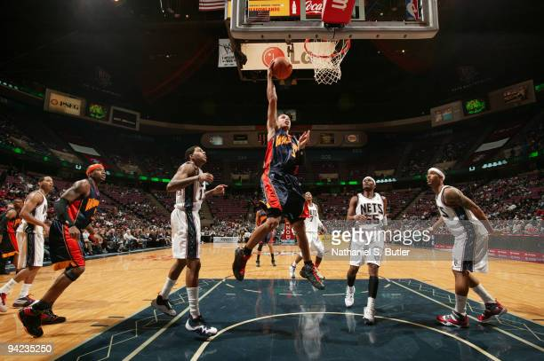 Stephen Curry of the Golden State Warriors shoots against the New Jersey Nets on December 9 2009 at the IZOD Center in East Rutherford New Jersey...