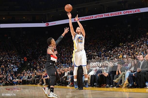 Stephen Curry of the Golden State Warriors shoots against the Portland Trail Blazers on March 11 2016 at Oracle Arena in Oakland California NOTE TO...