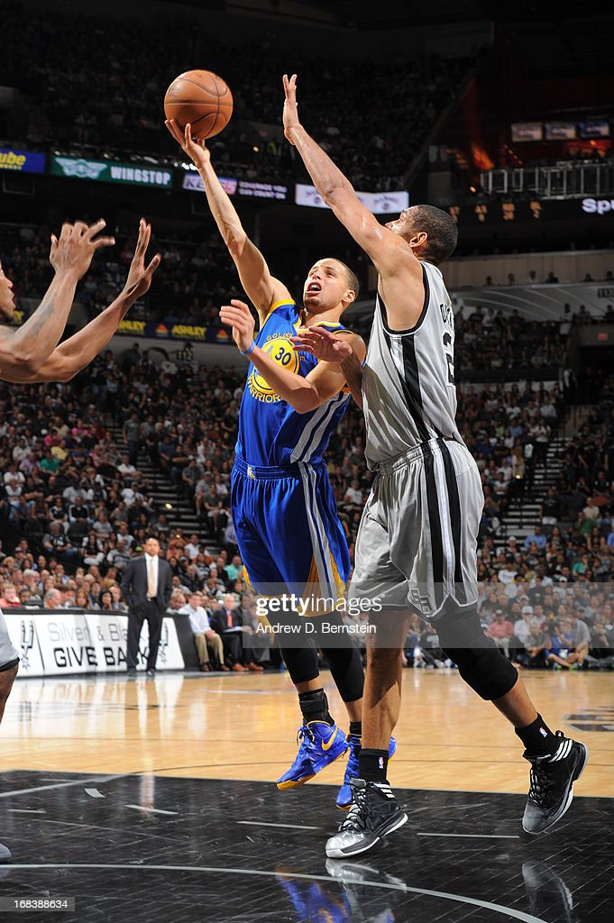 Stephen Curry #30 of the Golden State Warriors shoots against <a gi-track='captionPersonalityLinkClicked' href=/galleries/search?phrase=Tim+Duncan&family=editorial&specificpeople=201467 ng-click='$event.stopPropagation()'>Tim Duncan</a> #21 of the San Antonio Spurs in Game Two of the Western Conference Semifinals during the 2013 NBA Playoffs on May 8, 2013 at the AT&T Center in San Antonio, Texas.
