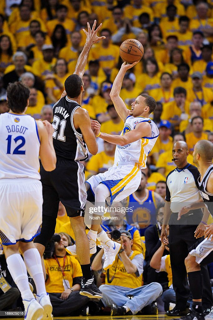 Stephen Curry #30 of the Golden State Warriors shoots against Tim Duncan #21 of the San Antonio Spurs in Game Six of the Western Conference Semifinals during the 2013 NBA Playoffs on May 16, 2013 at Oracle Arena in Oakland, California.