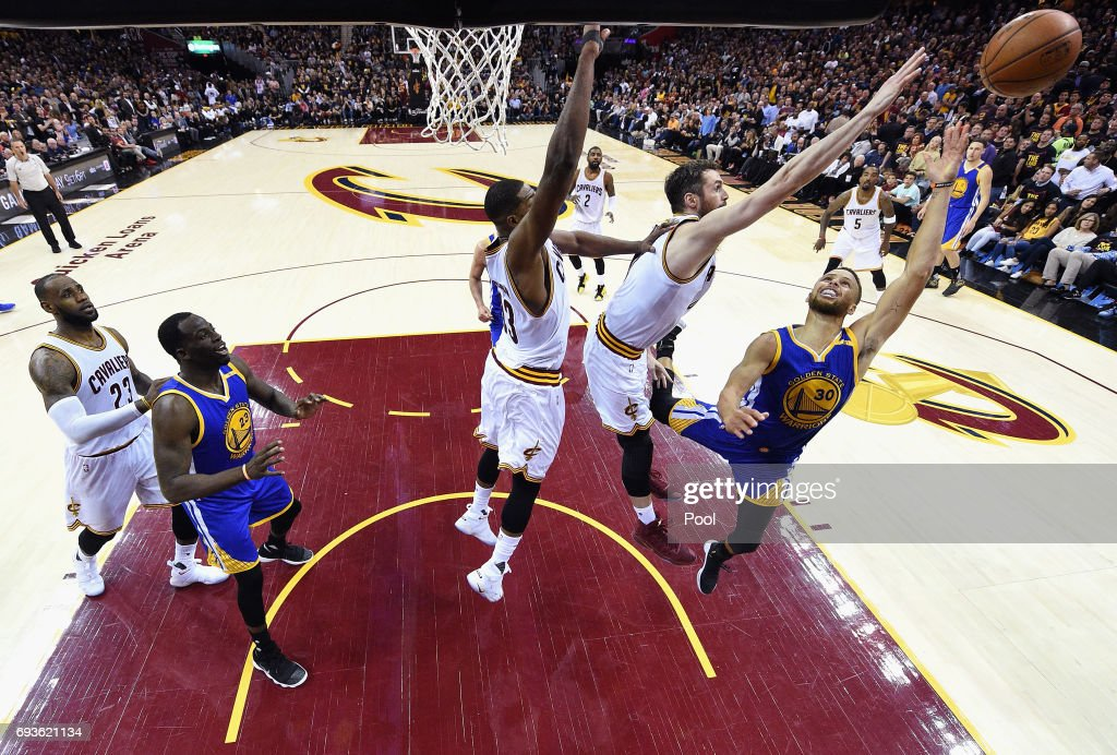 Stephen Curry #30 of the Golden State Warriors shoots against Tristan Thompson #13 and Kevin Love #0 of the Cleveland Cavaliers in the second half in Game 3 of the 2017 NBA Finals at Quicken Loans Arena on June 7, 2017 in Cleveland, Ohio.