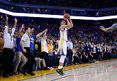Stephen Curry of the Golden State Warriors shoots and makes a threepoint basket in the final minute of their win against the Phoenix Suns at ORACLE...