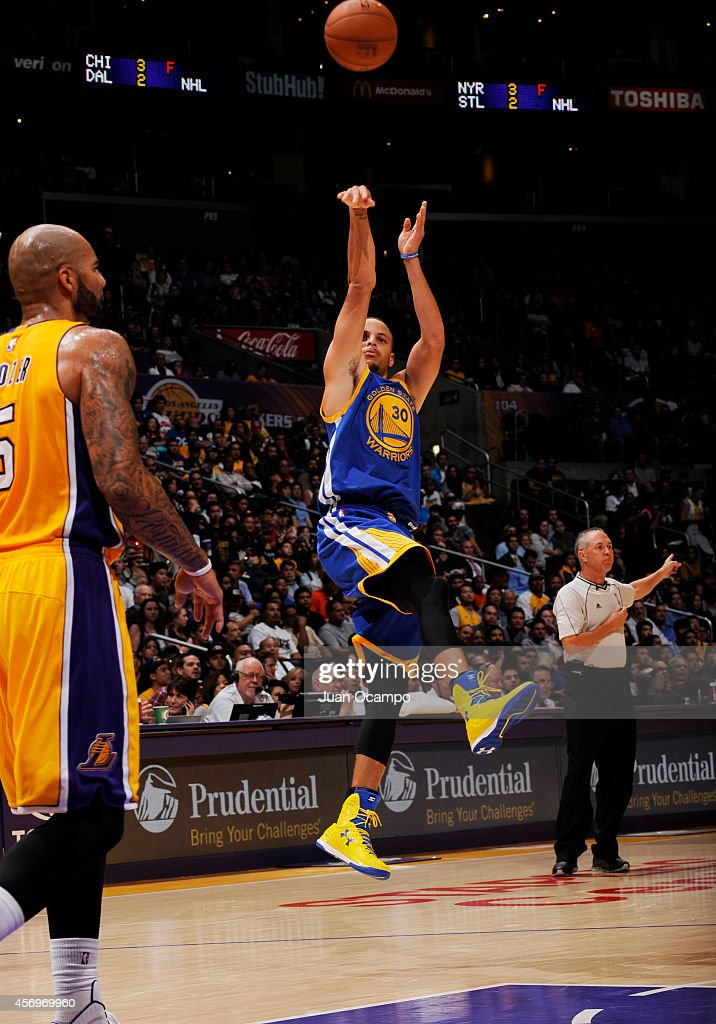 Stephen Curry #30 of the Golden State Warriors shoots during a game against the Los Angeles Lakers on October 9, 2014 at the Staples Center in Los Angeles, California.