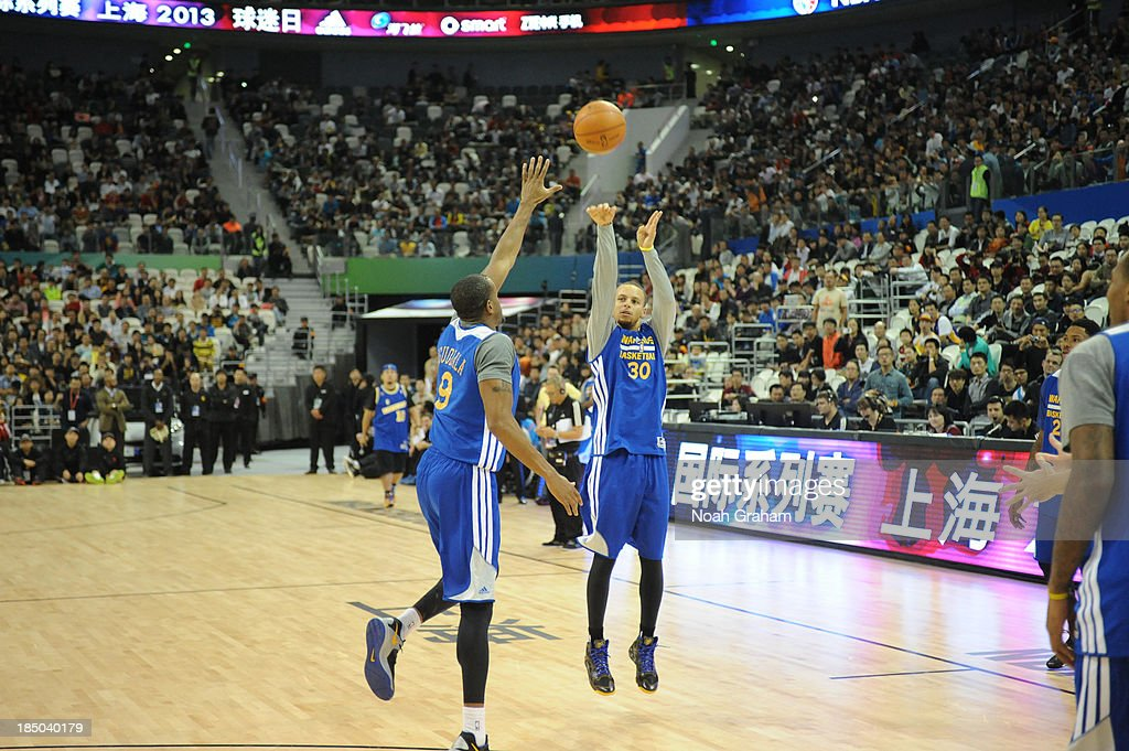 Stephen Curry of the Golden State Warriors shoots during Fan Appreciation Day as part of the 2013 Global Games on October 17, 2013 at the Oriental Sports Center in Shanghai, China.