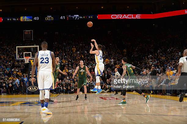 Stephen Curry of the Golden State Warriors shoots for three points against the Utah Jazz on March 9 2016 at Oracle Arena in Oakland California NOTE...