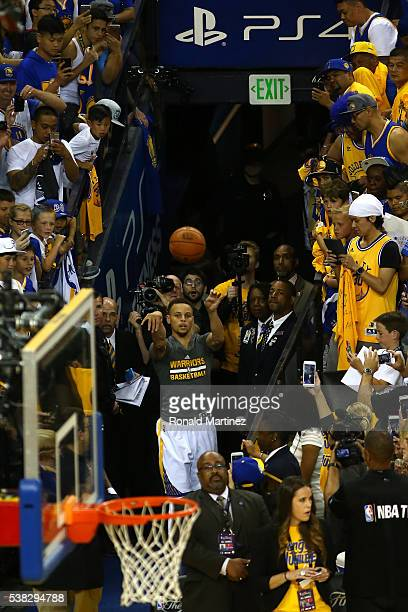 Stephen Curry of the Golden State Warriors shoots from the tunnel during warm ups prior to Game 2 of the 2016 NBA Finals at ORACLE Arena on June 5...